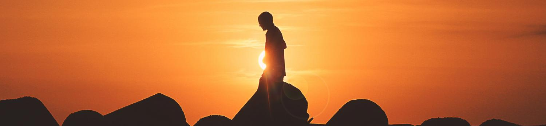 person walking during sunset