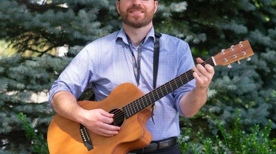 director john arthur with guitar